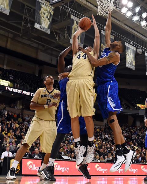 Dinos Mitoglou shot under basket.jpg