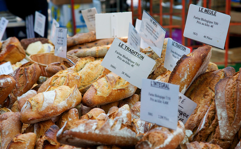 """Tradition of Bread French bread is famous.  It's a tradition.  Here is a loaf at the Arles market actually named """"le tradition.""""  Yummy."""