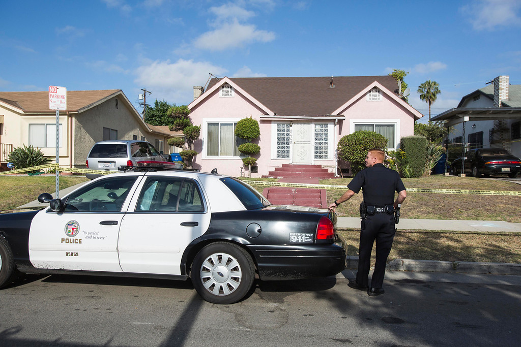 ". A police officer stands guard in front of the home of actor Michael Jace on Tuesday, May 20, 2014, in Los Angeles.  Jace, who played a police officer on the hit TV show ""The Shield,\"" was arrested on suspicion of homicide after his wife was found shot to death in their Los Angeles home, authorities said. Police arrived at the couple\'s home around 8:30 p.m. Monday after a report of shots fired, Officer Chris No said. April Jace, 40, was found dead inside, officials said.  Jace was taken into custody and booked early Tuesday on suspicion of homicide, No said. He was being held in a Los Angeles jail in lieu of $1 million bail.   (AP Photo/Ringo H.W. Chiu)"