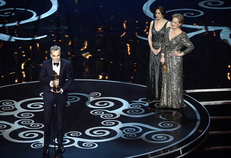". Actor Daniel Day-Lewis accepts the Best Actor award for ""Lincoln\"" from presenter Meryl Streep onstage during the Oscars held at the Dolby Theatre on February 24, 2013 in Hollywood, California.  (Photo by Kevin Winter/Getty Images)"