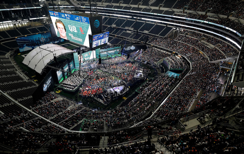 . USC\'s Sam Darnold is shown on the video screen after being selected by the New York Jets during the first round of the NFL football draft, Thursday, April 26, 2018, in Arlington, Texas. (AP Photo/David J. Phillip)
