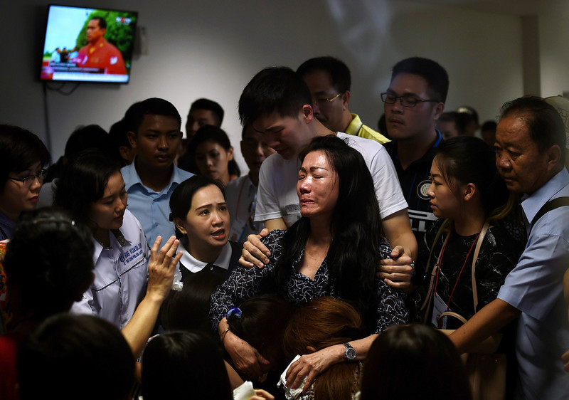 . Family members of passengers onboard the missing Malaysian air carrier AirAsia flight QZ8501 react after watching news reports showing an unidentified body floating in the Java sea, inside the crisis-centre set up at Juanda International Airport in Surabaya on December 30, 2014. Items resembling an emergency slide, plane door and other objects were spotted during a aerial search on December 30 for the missing AirAsia plane, according to information from the flight on which AFP was aboard. MANAN VATSYAYANA/AFP/Getty Images