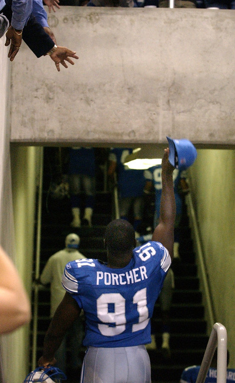. Detroit Lions defensive end Robert Porcher tosses his hat to the fans as he walks down the tunnel to the lockeroom following the Detroit Lions 34-22 loss to the Pittsburgh Steelers at Ford Field Sat. Aug. 24, 2002.
