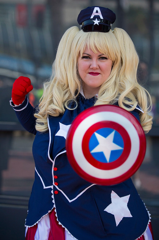 ". Cosplayer Laura Stevens poses in her ""Lolita Captain America\"" costume, inspired by comic book character \""Captain America\"", during the 2013 San Diego Comic-Con (SDCC) International in San Diego, California July 18, 2013. REUTERS/Fred Greaves"