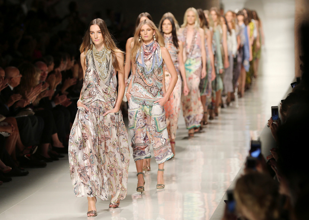 . Models wear creations for Etro women\'s Spring-Summer 2014 collection, part of the Milan Fashion Week, unveiled in Milan, Italy, Friday, Sept. 20, 2013. (AP Photo/Antonio Calanni)