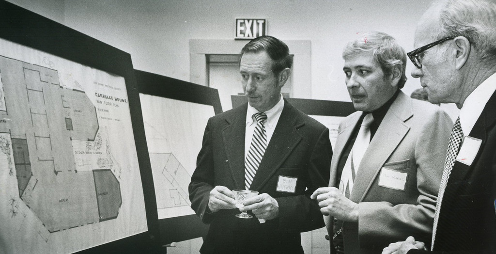 . February 1976: The historic buildings, including the log cabin in which James A. Garfield was born, were purchased by the Lake County Historical Society, and plans were unveiled for using the land behind Lawnfield in Mentor. Mentor architect Tom Marcel, center, discusses plans for the Carriage House with society members Bill Hachtel, left, and Bill Kern. (News-Herald file)