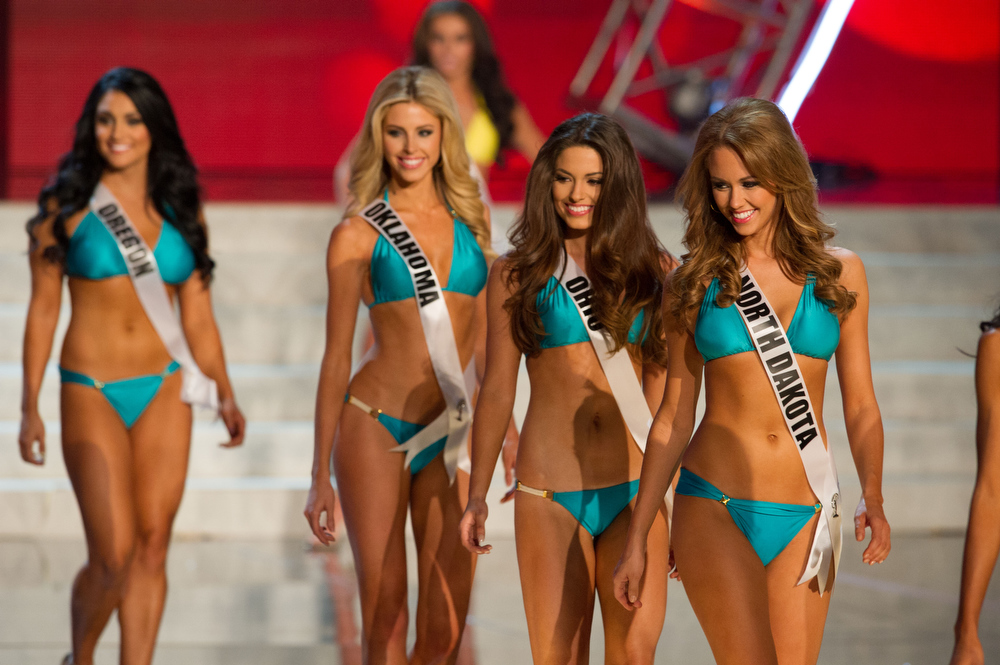 . In this photo provided by the Miss Universe Organization,  Miss North Dakota USA 2013, Stephanie Erickson; Miss Ohio USA 2013, Kristin Smith; Miss Oklahoma USA 2013, Makenzie Muse; and Miss Oregon USA 2013, Gabrielle Neilan; compete in their swimsuits during the  2013 Miss USA Competition Preliminary Show in Las Vegas on Wednesday June 12, 2013.   She will compete for the title of Miss USA 2013 and the coveted Miss USA Diamond Nexus Crown on June 16, 2013.  (AP Photo/Miss Universe Organization, Darren Decker)