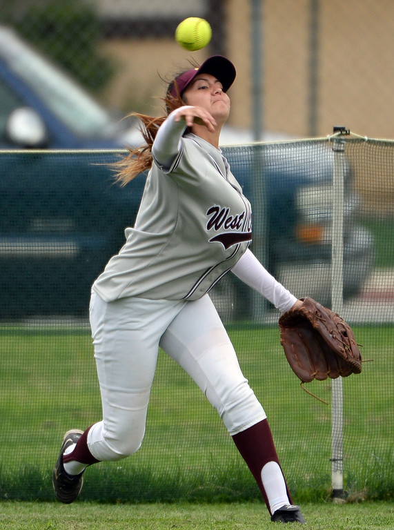 . West Covina\'s Alyssa Arias catches a drives by Bonita\'s Kaelyn Mc Fadden (not pictured) in the fourth inning of a prep softball game at Los Flores Park in La Verne, Calif., on Thursday, March 27, 2014. Bonita won 6-3. (Keith Birmingham Pasadena Star-News)