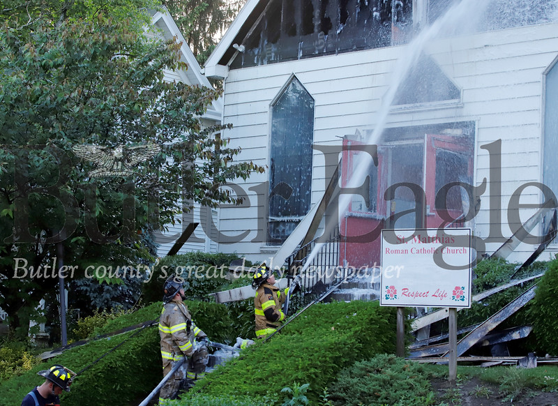 Fire crews from multiple departments responded to Wednesday nights fire at St. Matthias Roman Catholic Church in Evans City. Seb Foltz/Butler Eagle