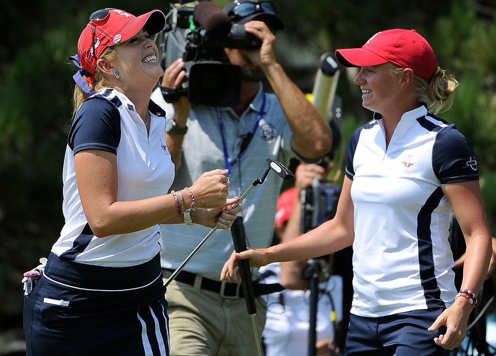 . PARKER, CO - Aug.17: Team USA\'s Paula Creamer, left, and Stacy Lewis celebrate their match win on the 18th hole. The 2013 Solheim Cup takes place at the Colorado Golf Club with the USA taking on Europe in the Saturday morning Foursomes Match. (Photo By Kathryn Scott Osler/The Denver Post)