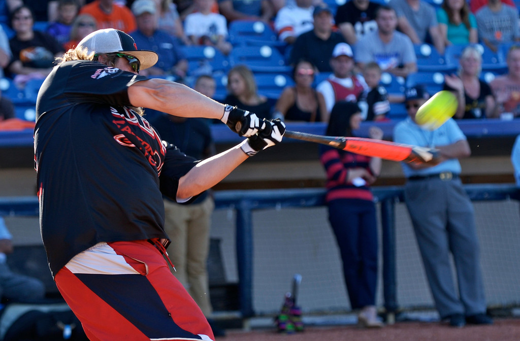 . Jeff Forman/JForman@News-Herald.com Kyle Moyer hits it out of the park during the Joe Haden and Friends Softball Game home run derby July 17 at Classic Park.