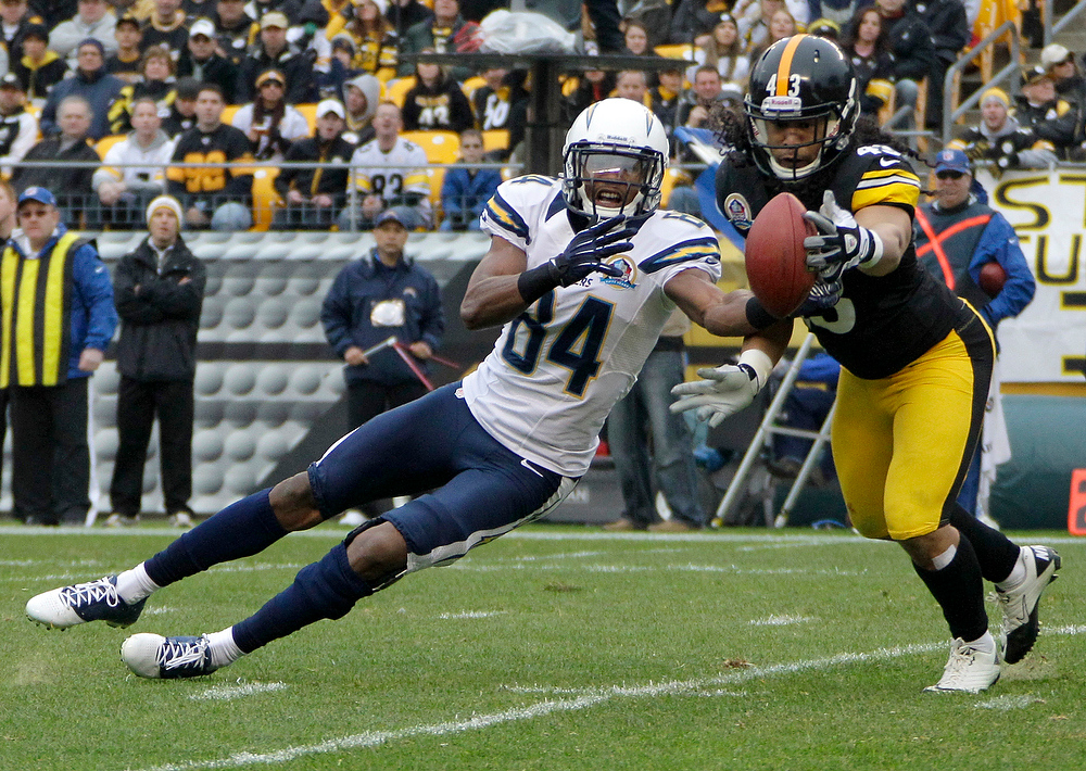 . Pittsburgh Steelers strong safety Troy Polamalu (43) tries to intercept a pass intended for San Diego Chargers wide receiver Danario Alexander (84) in the second quarter an NFL football game in Pittsburgh, Sunday, Dec. 9, 2012. Polamalu did not get the ball. (AP Photo/Gene J. Puskar)