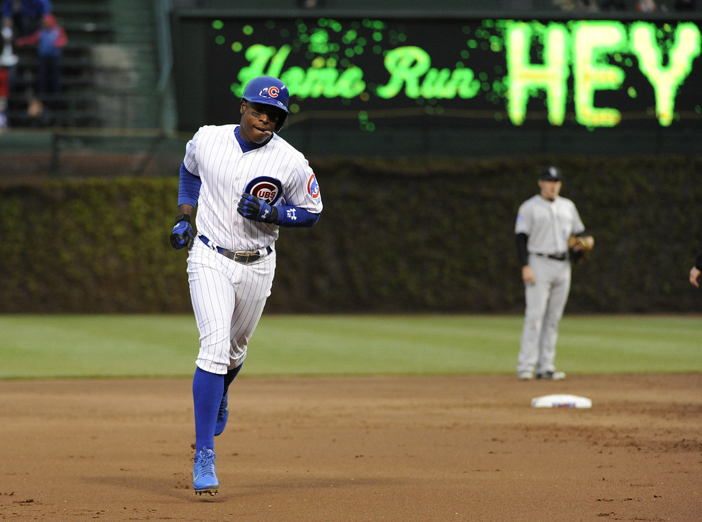 . Alfonso Soriano #12 of the Chicago Cubs runs the bases after hitting a two-run homer against the Colorado Rockies during the first inning on May 13, 2013 at Wrigley Field in Chicago, Illinois.   (Photo by David Banks/Getty Images)