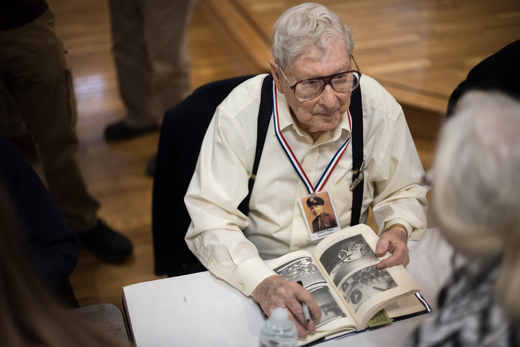 """. 03/26/17 LEOMINSTER with story--World War II veteran Charles R. Rogers browses a book during Sundays book signing of \""""My Father\'s War\"""" written by local author Charley Valera.  The World War II veterans featured in the book came together on Sunday to sign books on March 26, 2017 at the Veterans Center in Leominster.  (Sentinel & Enterprise photo/Jeff Porter)"""