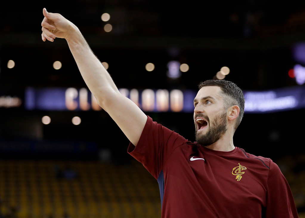 . Cleveland Cavaliers forward Kevin Love warms up before Game 1 of basketball\'s NBA Finals between the Golden State Warriors and the Cavaliers in Oakland, Calif., Thursday, May 31, 2018. (AP Photo/Marcio Jose Sanchez)
