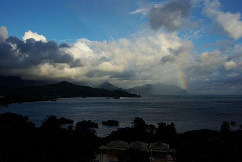 Rainbow and broken clouds over Kaneohe Bay.