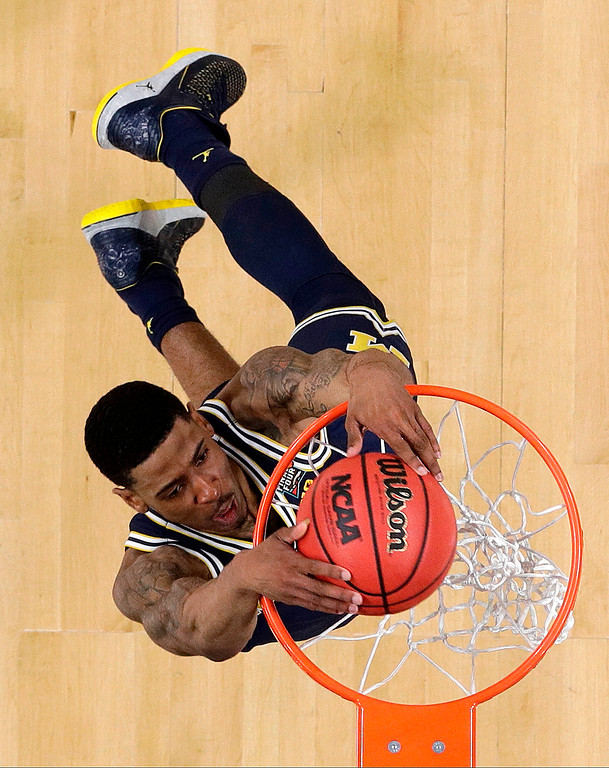 . Michigan\'s Charles Matthews dunks during the first half in the championship game of the Final Four NCAA college basketball tournament against Villanova, Monday, April 2, 2018, in San Antonio. (AP Photo/David J. Phillip)