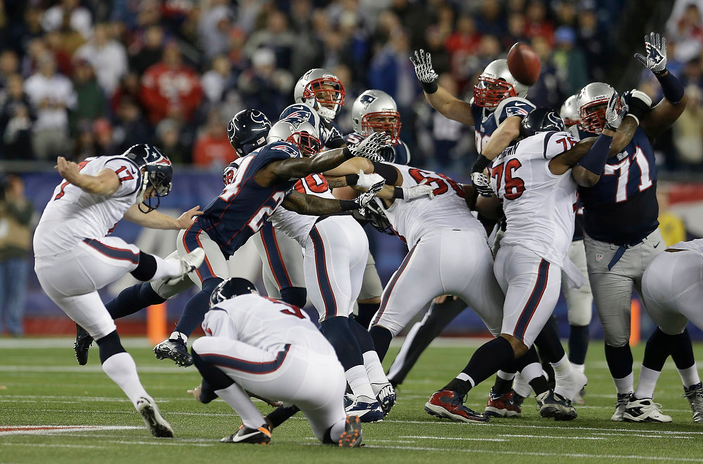 . Houston Texans kicker Shayne Graham, left, kicks a 55-yard field goal during the first half of an AFC divisional playoff NFL football game against the New England Patriots in Foxborough, Mass., Sunday, Jan. 13, 2013. (AP Photo/Elise Amendola)