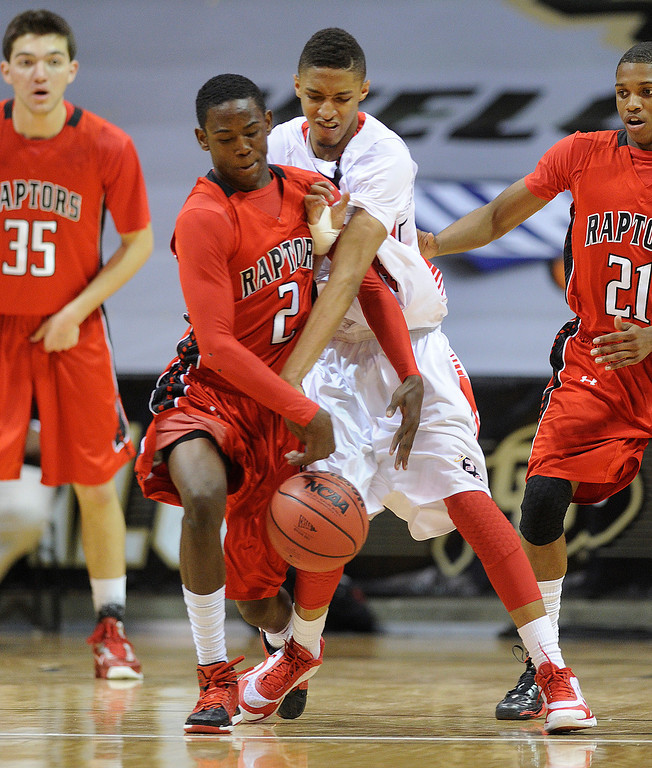 . BOULDER, CO. - MARCH 16: Raptors senior guard TreShawn Wilford (2) snatched the ball from East guard Dominique Collier (24) in the first half. The Denver East High School boy\'s basketball team met Eaglecrest in the 5A championship game Saturday, March 16, 2013 at the Coors Events Center in Boulder.  (Photo By Karl Gehring/The Denver Post)