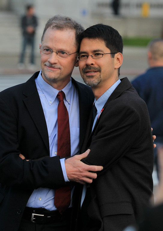 . Partners John Lewis, left, and Stuart Gaffney, of San Francisco, await the the Supreme Court\'s decision on Proposition 8 and the Defense of Marriage Act during a screening at City Hall in San Francisco, Calif., on Wednesday, June 26, 2013. The U.S. Supreme Court dismissed California\'s Proposition 8 and declared the 1996 Defense of Marriage Act unconstitutional. (Jane Tyska/Bay Area News Group)