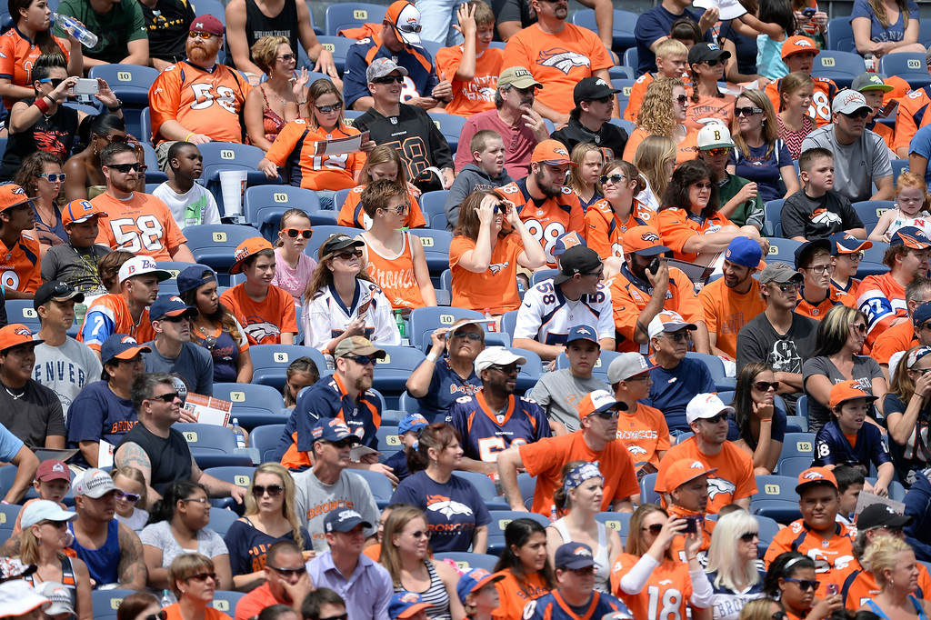 . Denver Broncos fans  attend day four of the Denver Broncos 2014 training camp July 27, 2014 at Sports Authority Field at Mile High. (Photo by John Leyba/The Denver Post)