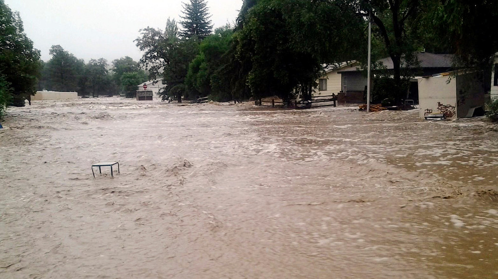 . This image provided by Jason Stillman, shows flooding in Lyons Colo., Thursday Sept. 12, 2013. Boulder County Sheriff Joe Pelle said the town of Lyons was completely cut off because of flooded roads. Flash flooding in Colorado has cut off access to towns, closed the University of Colorado in Boulder and left at least three people dead. (AP Photo/Jason Stillman)