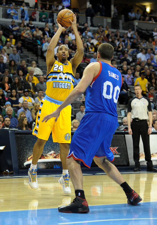 . DENVER, CO. - MARCH 21: Andre Miller (24) of the Denver Nuggets launched a jumper over Spencer Hawes (00) of the Philadelphia 76ers in the first half. The Denver Nuggets hosted the Philadelphia 76ers Thursday night, March 21, 2013 at the Pepsi Center. (Photo By Karl Gehring/The Denver Post)