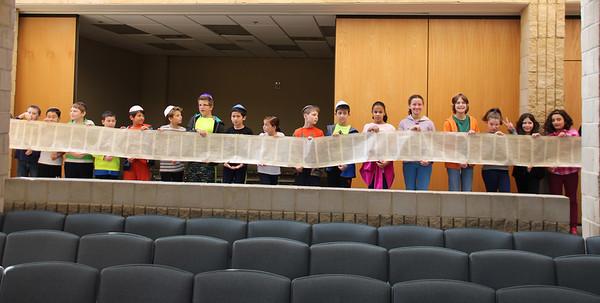 OTRS Unrolls a Torah Scroll