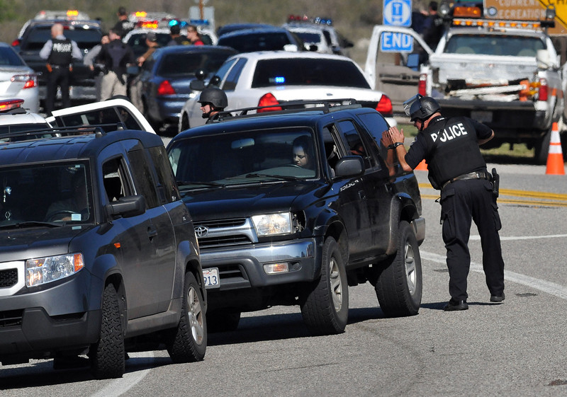 . San Bernardino County Sheriffs, assisted by multiple agencies from the region, block Highway 38 at Bryant St. following a gunfight with Christopher Dorner further up the highway. Dorner shot two police officer, killing one and injuring the other, both men were transported to Loma Linda University Medical Center for treatment, Tuesday, Feb. 12, 2013. (Staff photo by Gabriel Luis Acosta/The Sun)