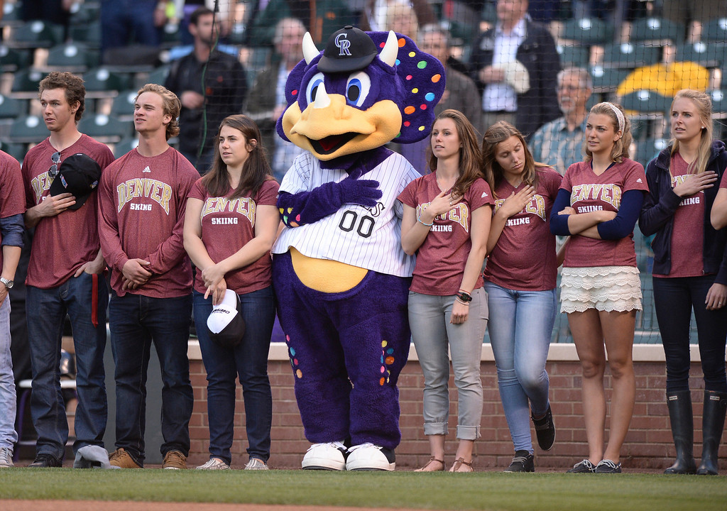 . Dinger stood with the University of Denver ski team during the National Anthem before the game Wednesday night. The Colorado Rockies hosted the San Francisco Giants Wednesday night, May 21, 2014.  (Photo by Karl Gehring/The Denver Post)