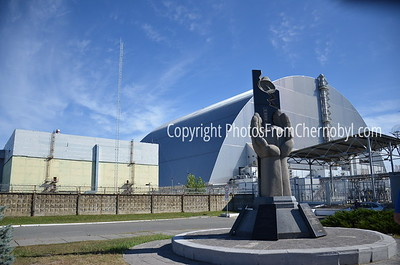 Monument to the Chernobyl Victims in front of the sarcophagus over Reactor 4, Chernobyl Nuclear Power Plant in Zone of Alienation, Ukraine