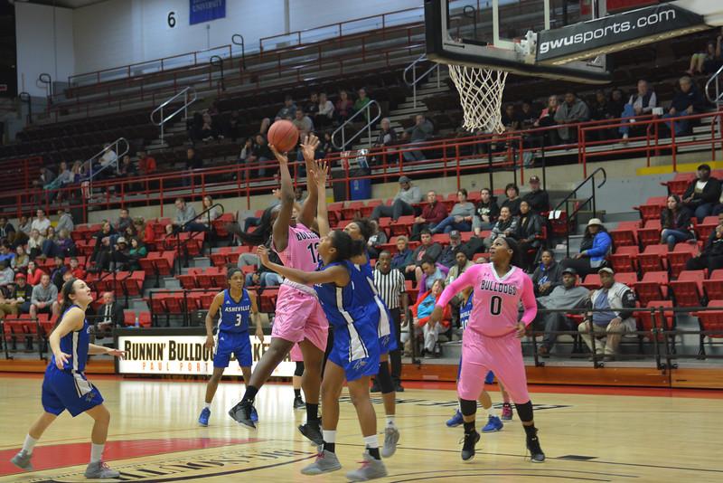 Number 12, Evelyn Adebayo shooting the ball