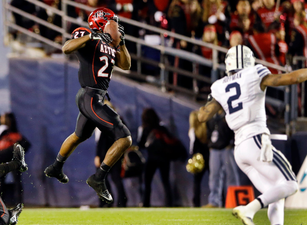 . San Diego State defensive back Eric Pinkins (27) intercepts a pass in front of BYU wide receiver Cody Hoffman (2) during the second quarter of the Poinsettia Bowl NCAA college football game, Thursday, Dec. 20, 2012, in San Diego. Pinkins returned the interception into the end zone but the touchdown was nullified by a penalty. (AP Photo/Lenny Ignelzi)