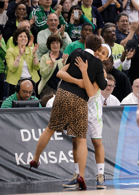 . Notre Dame guard Skylar Diggins right gets a hug from coach Muffet McGraw during the second half of the regional final of the NCAA women\'s college basketball tournament Tuesday, April 2, 2013, in Norfolk, Va. Notre Dame won 87-76. (AP Photo/Steve Helber)