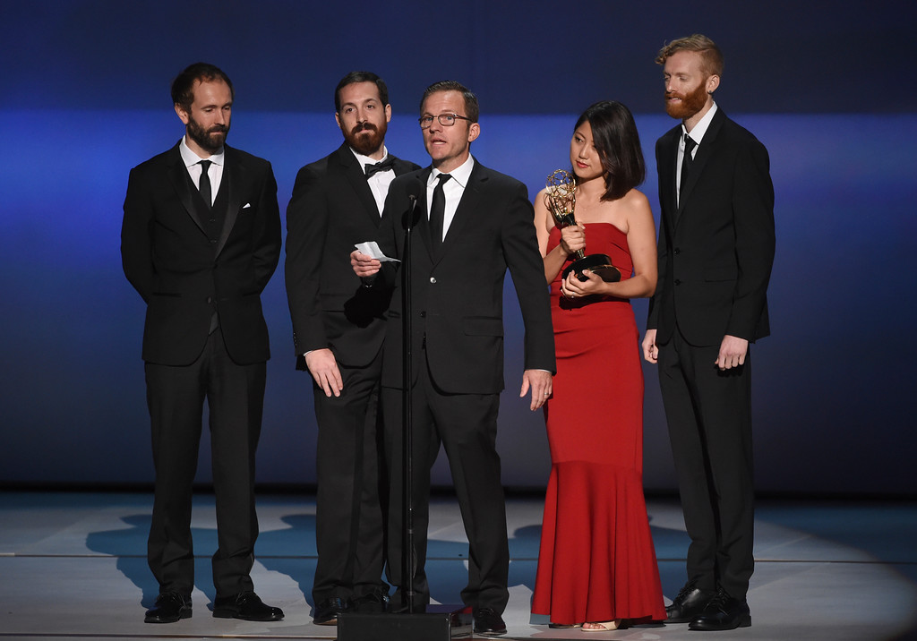 ". Chris King, from left, Daniel de Graaf, Mike Houston, Naoko Saito and Ryan Frost accept the award for outstanding motion design for ""Wasted! The Story of Food Waste Wasted!\"" during night two of the Television Academy\'s 2018 Creative Arts Emmy Awards at the Microsoft Theater on Sunday, Sept. 9, 2018, in Los Angeles. (Photo by Phil McCarten/Invision/AP)"