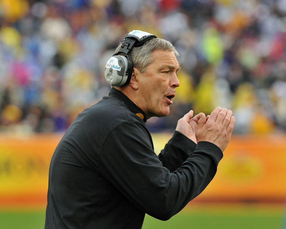 . Coach Kirk Ferentz of the Iowa Hawkeyes directs play against the LSU Tigers January 1, 2014  in the Outback Bowl at Raymond James Stadium in Tampa, Florida.  (Photo by Al Messerschmidt/Getty Images)