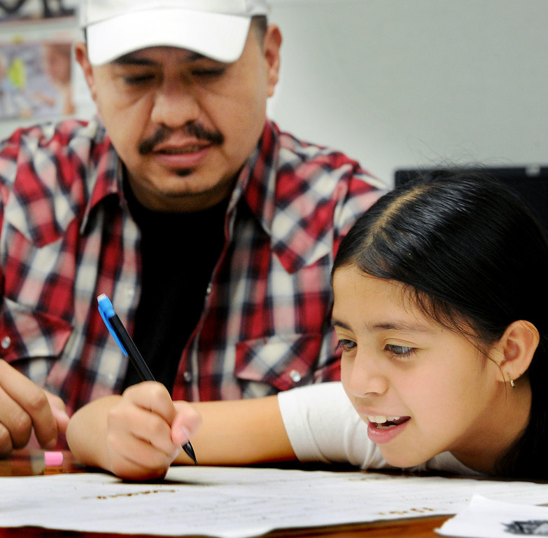 ". Manuel Davila, helping his daughter Ana Davila with lesson at Elwin Elementary School in Baldwin Park host, ""Bring Your Dad to School\"" Day Wednesday, October 2, 2013.(Walt Mancini/San Gabriel Valley Tribune)"