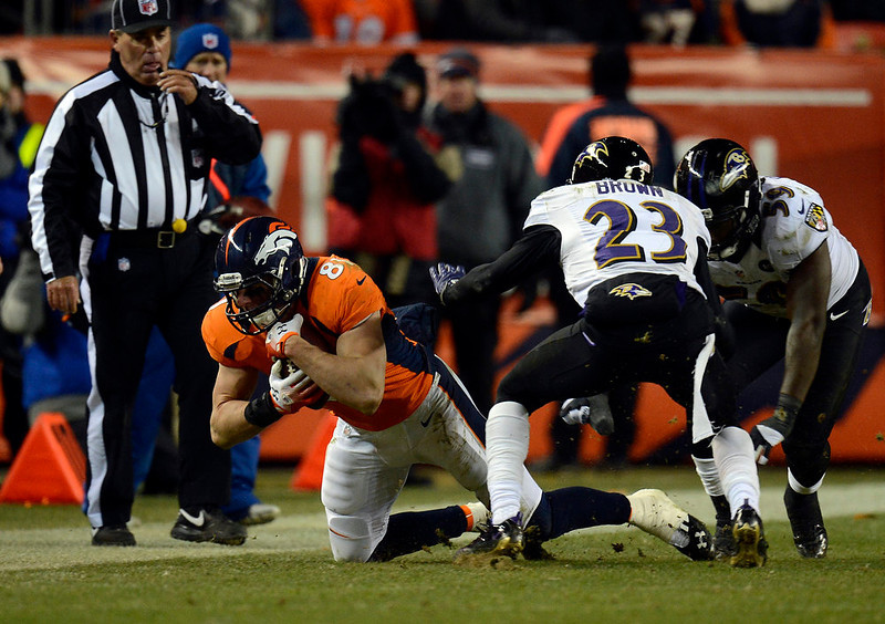 . Denver Broncos tight end Joel Dreessen (81) goes down in the second half.  The Denver Broncos vs Baltimore Ravens AFC Divisional playoff game at Sports Authority Field Saturday January 12, 2013. (Photo by Joe Amon,/The Denver Post)