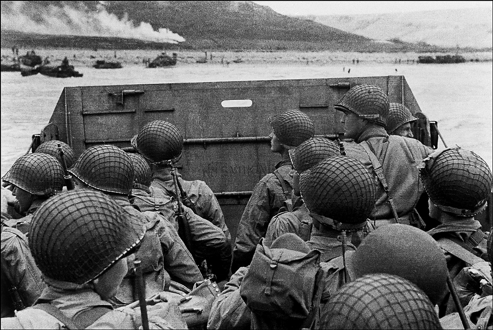Description of . US assault troops approach Utah Beach in a barge, 06 June 1944 as Allied forces storm the Normand beaches on D-Day. D-Day, is still one of the world's most gut-wrenching and consequential battles, as the Allied landing in Normandy led to the liberation of France which marked the turning point in the Western theater of World War II.  STF/AFP/Getty Images