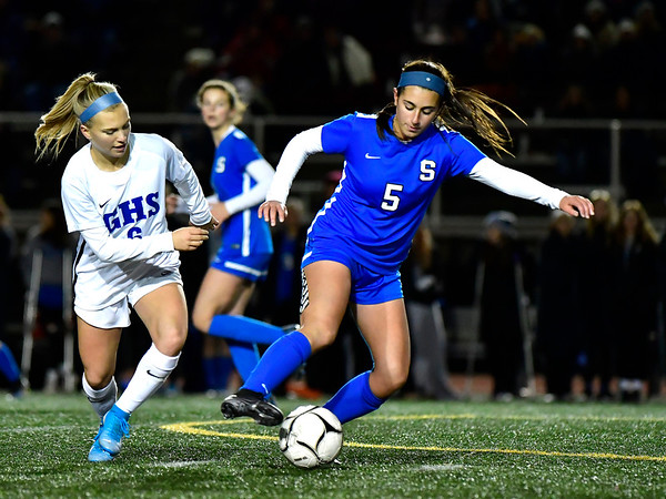 11/23/2019 Mike Orazzi | Staff Glastonbury's Mackenzie Baker (6) and Southington High School's Marisa Imme (5) during the Class LL Girls State Soccer Tournament at Veterans Stadium in New Britain Saturday evening. Glastonbury defeated Southington 1-0.
