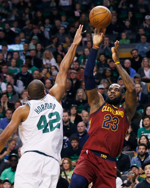 . Cleveland Cavaliers forward LeBron James (23) shoots against Boston Celtics forward Al Horford (42) during the first quarter of Game 1 of the NBA basketball Eastern Conference Finals, Sunday, May 13, 2018, in Boston. (AP Photo/Michael Dwyer)