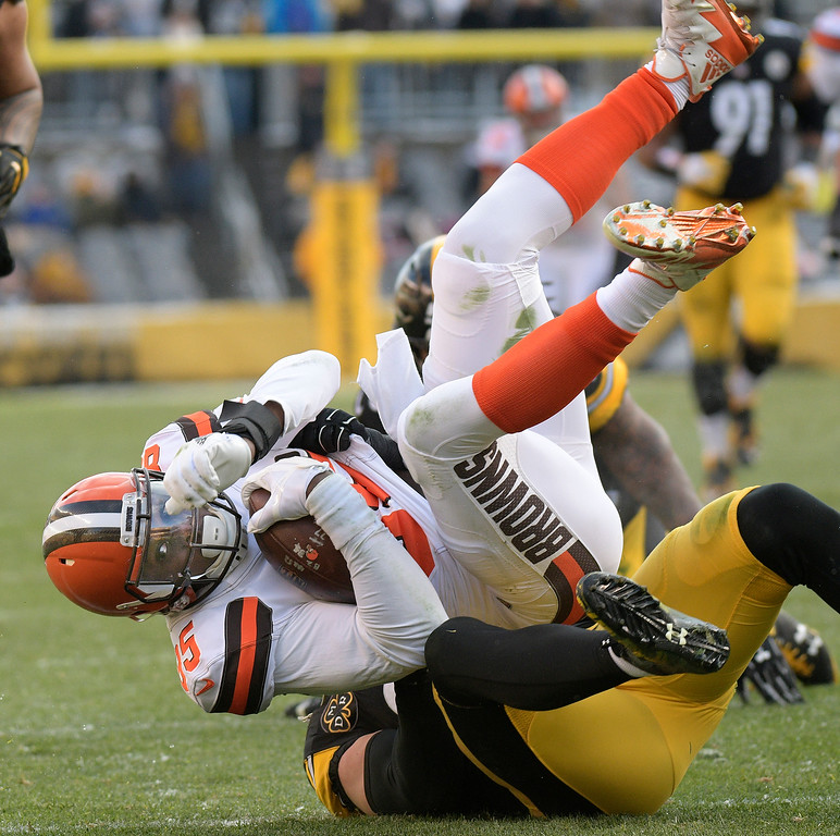 . Cleveland Browns tight end David Njoku (85) is tackled by Pittsburgh Steelers outside linebacker T.J. Watt (90) during the second half of an NFL football game in Pittsburgh, Sunday, Dec. 31, 2017. (AP Photo/Don Wright)