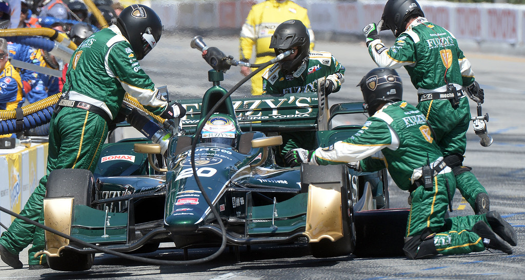 . Luca Filippi makes a pit stop during Sunday\'s race. Scott Dixon (9) wins the Toyota Grand Prix of Long Beach Sunday April 19, 2015.  (Will Lester/Staff Photographer)
