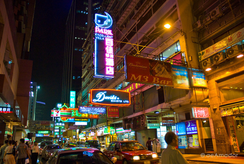 aeamador©-HK08_DSC0133      Hong Kong. Kowloon. Tsim Sha Tsui. Though not to be compared with what you find in Hong Kong island, it is quite a vibrant and lively city. People fill up the streets and sidewalks day and night for shopping, entertainment and more. Signs make a great show, especially at night, giving vibrancy and character to the city.