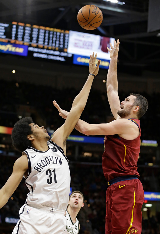 . Cleveland Cavaliers\' Kevin Love, right, shoots against Brooklyn Nets\' Jarrett Allen (31) in the second half of an NBA basketball game, Wednesday, Nov. 22, 2017, in Cleveland. (AP Photo/Tony Dejak)