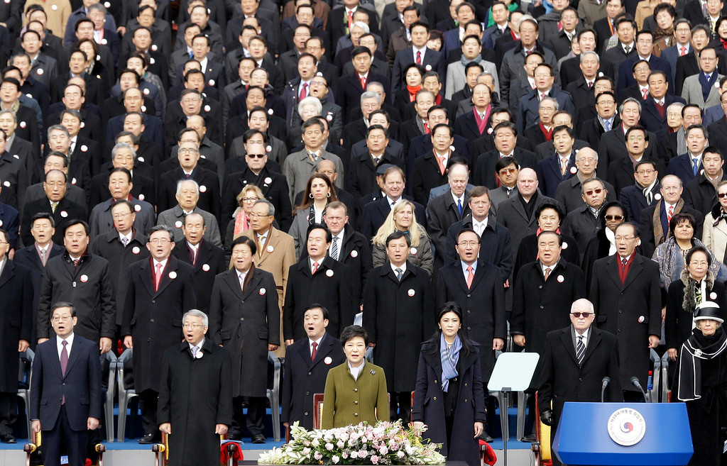 . South Korea\'s new President Park Geun-hye, front row center, sings the national anthem during her inauguration ceremony as the 18th South Korean president in Seoul, South Korea, Monday, Feb. 25, 2013.  (AP Photo/Lee Jin-man)