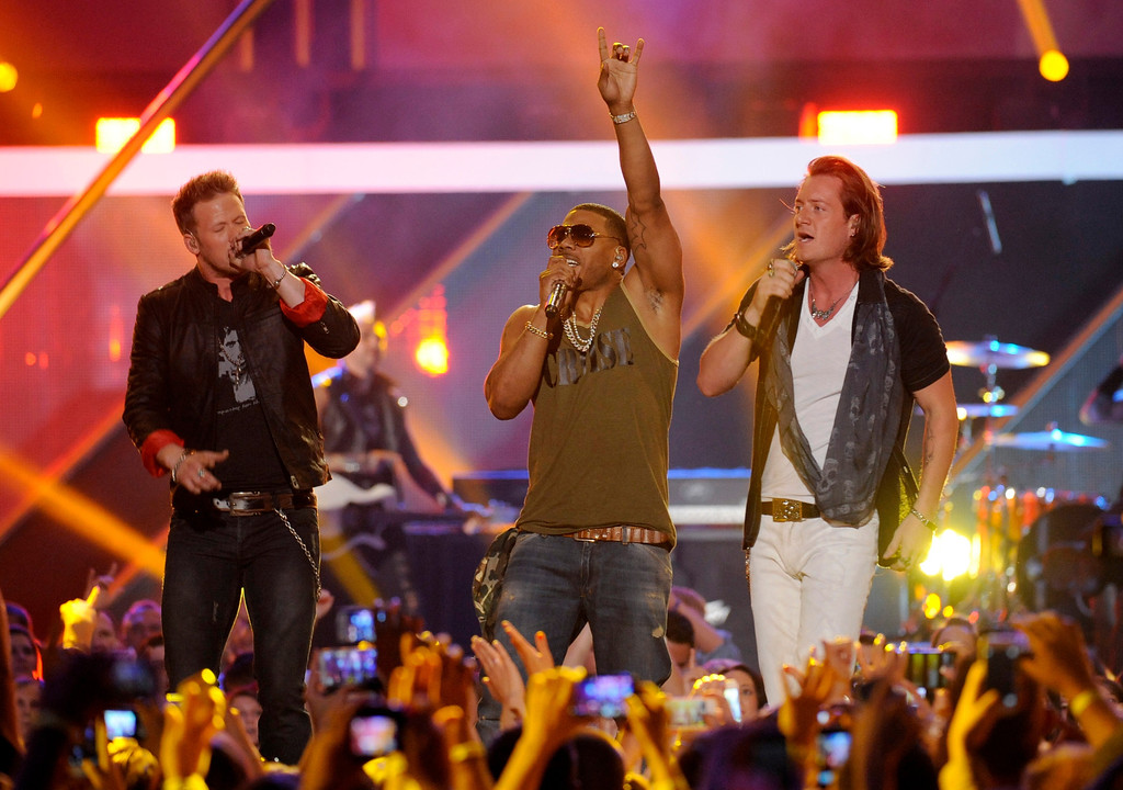 . Brian Kelley, left, and Tyler Hubbard, right, of Florida Georgia Line, and Nelly perform at the 2013 CMT Music Awards at Bridgestone Arena on Wednesday, June 5, 2013, in Nashville, Tenn. (Photo by Donn Jones/Invision/AP)