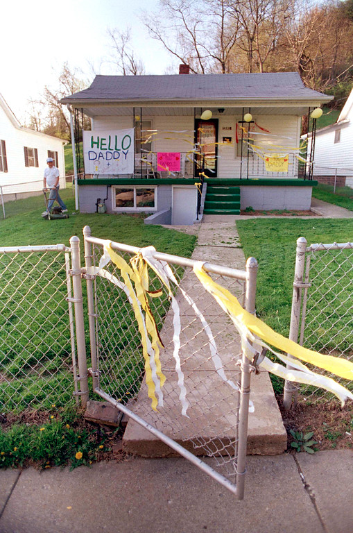 . Yellow ribbons adorn the front gate of prison guard Darrold Clark\'s Portsmouth, Ohio, home, April 18, 1993.  Clark is one of the prison guards released by inmates holding five guards hostage at the Southern Ohio Correctional Facility.  (AP Photo/Chris Kasson)