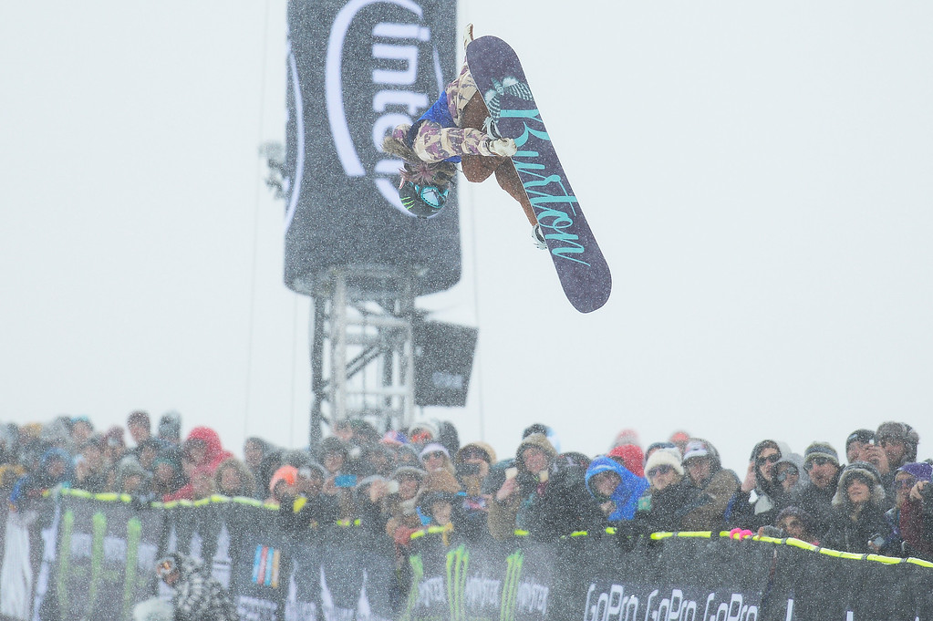 . ASPEN, CO - JANUARY 31: Chloe Kim goes for a grab in her first run during the women\'s snowboard halfpipe finals at Winter X Games 2016 at Buttermilk Mountain on January 31, 2016 in Aspen, Colorado. Chloe Kim won the event with a score of 95, giving Kim her second gold medal and third overall. (Photo by Brent Lewis/The Denver Post)