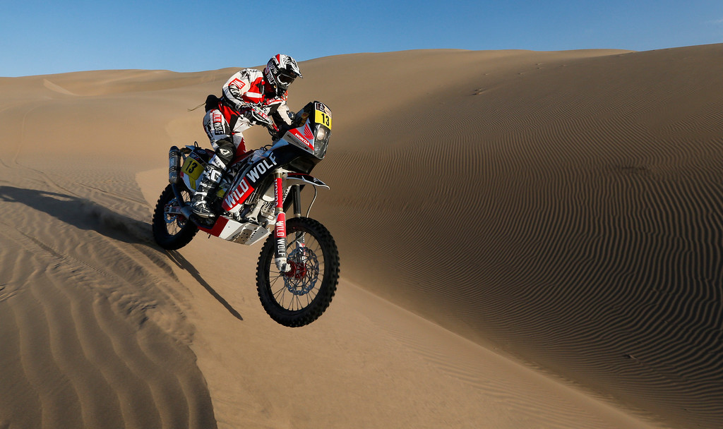 . Honda rider Gerard Farres Guell of Spain competes in the 4nd stage of the 2013 Dakar Rally from Nazca to Arequipa, Peru, Tuesday, Jan. 8, 2013. The race finishes in Santiago, Chile, on Jan. 20. (AP Photo/Victor R. Caivano)